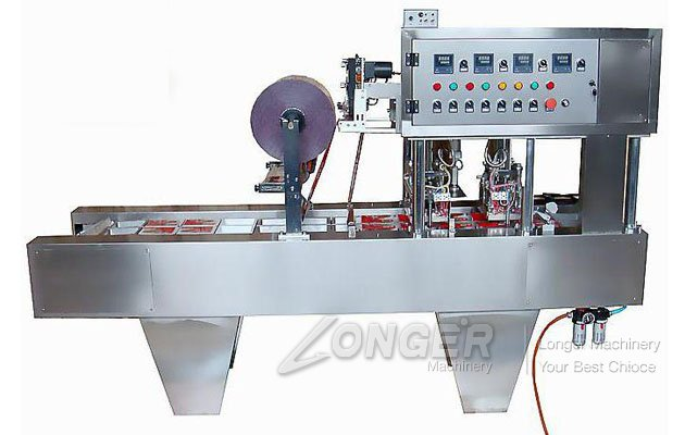 Continuous Food Tray Filling And Sealing Machine Manufacturer